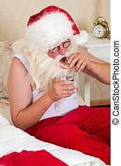 Santa Claus with false dentures - Santa Claus putting his...