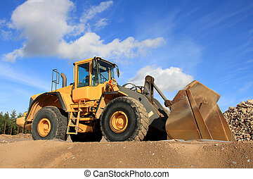 Wheel Loader at Sand Pit - Yellow wheel loader at sand pit...