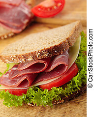 fresh deli sandwich with tomatoes, swiss cheese, lettuce