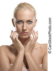 beauty portrait of blonde girl with fingers near the face