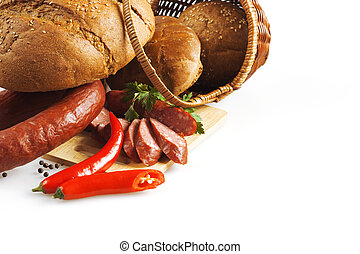 meat and wheat products on a white background