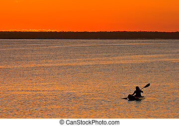 Mozambican sunset - Golden sunset with canoeist, Vilanculos...