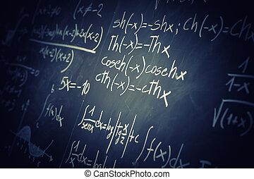 blackboard - closeup image of classic blackboard with math...