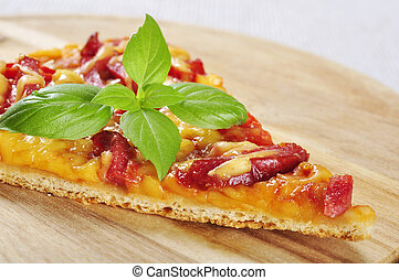 slice of pizza closeup on a wooden cutting board