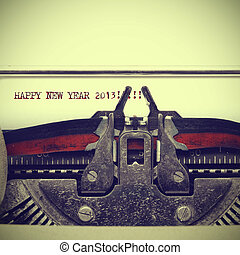happy new year 2013 written with an old typewriter with a...