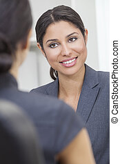 Hispanic Latina Woman or Businesswoman in Office Meeting -...