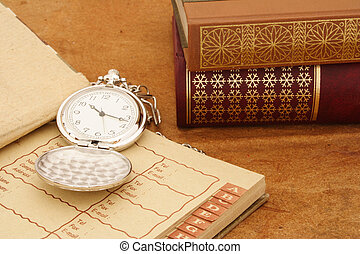 Business items - Old watch on open agenda and books