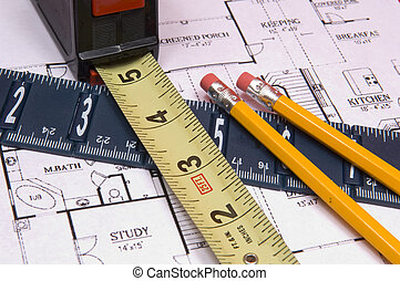 Measuring Tape and Ruler with pencils on house floorplan -...