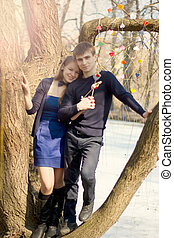 Young couple in blue dress on a tree