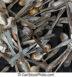 Old cutlery on black background