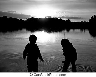 Two Boys - Sunset and two small young boys on the lake