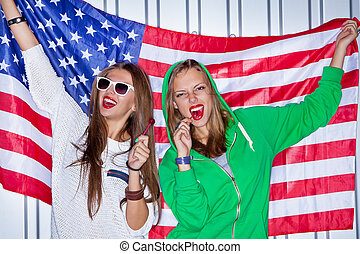 Beautiful patriotic girls with lollipop - Two beautiful...