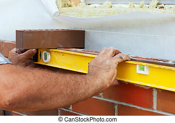 Bricklaying - Bricklayer hands with