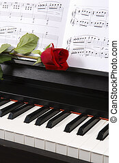 Piano with Sheet Music and a Rose - Sheet music with rose on...