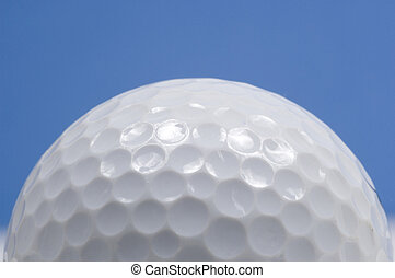 Golf ball close-up - golf ball close up with blue sky