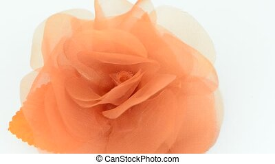 Orange fabric flower on a white background