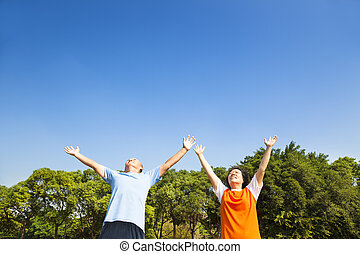 relaxed asian mature couple looking sky