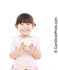 asian little girl holding a glass of fresh milk