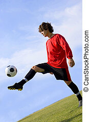 Soccer - Football Player Juggling in Red