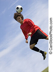 Soccer Football Player making Header - Soccer - Football...