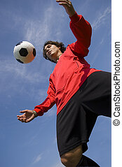 Soccer Football Player in red controlling ball