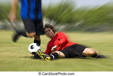 Football - Soccer - Tackle - Football - Soccer player making...