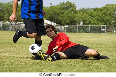 Football - Soccer - Tackle! - Football - Soccer player...