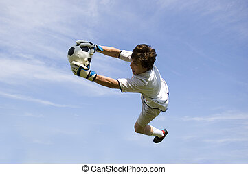 Soccer Football Goal Keeper making Save - Soccer Football...