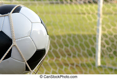 Football - Soccer ball in Goal - Football - soccer ball in...