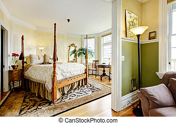 Large historical Inn room interior - bedroom with antique bed.