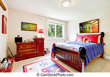 Baby boy Bedroom with wood furniture and colorful art. -...