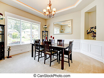 Large luxury dining room with dark wood furniture.