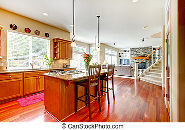 Wood luxury large kitchen, living room with red and granite.