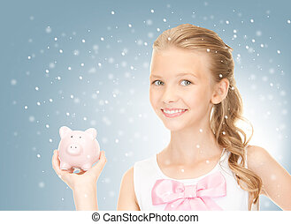 lovely teenage girl with piggy bank - picture of lovely...