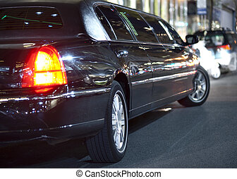 Black limo - Low angle view of black limousine in city at...