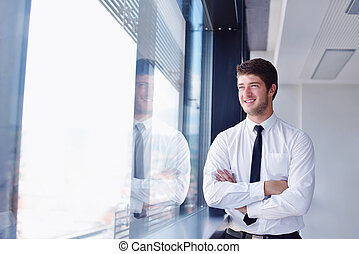 happy young business man at office - happy young business...