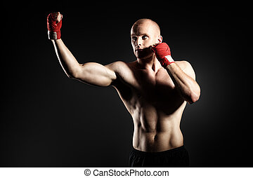 active sport - Portrait of a muscular boxer in red gloves...