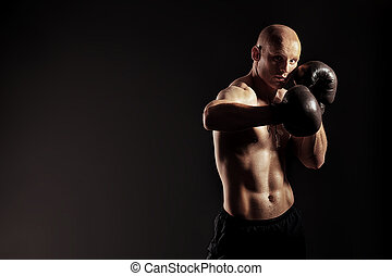 boxing guy - Portrait of an aggressive boxer in gloves...