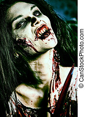 undead woman - Bloodthirsty zombi with a knife standing at...