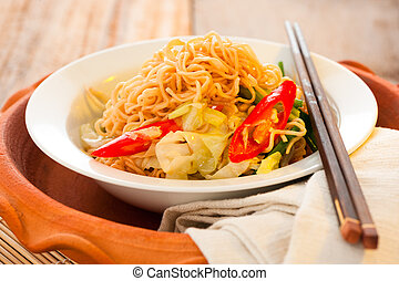 Asian noodles - Asian vegetables noodles in white plate and...
