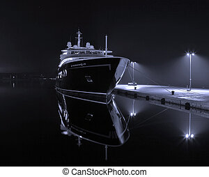 Yacht in harbor - modern yacht in autumn night
