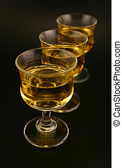 Cordials - Three cordials in a skewed line with gold liquid