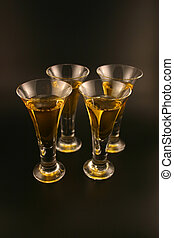 Cordials - Four cordials with gold liquid