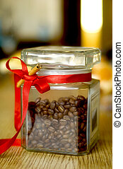 jar with coffee grain on a table and cinnamon