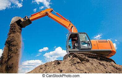 Excavator unloading soil or sand - Excavator with metal...