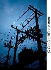 Silhouette of electric transformer substation.