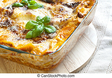 Lasagne - Freshly baked lasagne with fresh basil on top
