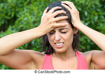 Woman painful head ache - Young sportwoman suffering severe...