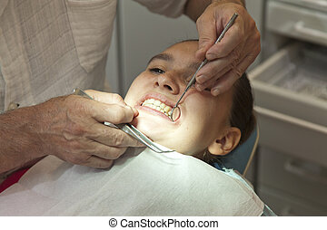 Girl having teeth checkup - Cute girl having her teeth...