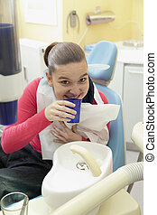 Girl rinsing mouth - Cute happy girl rinsing mouth after...